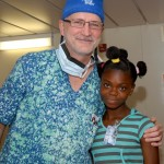 A former patient is greeted and welcomed by Dr Gary Parker aboard Mercy Ships.
